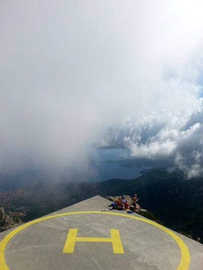 Air Vehicle Airport Runway Cloud Day Dividing Line Dramatic Sky Fog High Angle View Journey Mountain Outdoors Road Marking Sky The Way Forward Tranquil Scene Tranquility Transportation Yellow