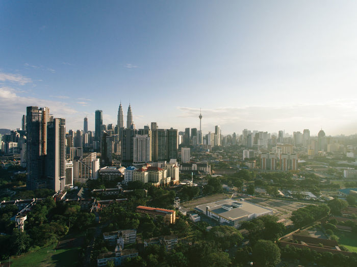 Kuala Lumpur city skyline in evening view ASIA Atmosphere Kuala Lumpur Architecture Building Exterior Built Structure City Cityscape Crowded Day Development Enviroment Evening High Angle View Infrastructure Landscape Malaysia Modern Sky Skyline Skyscraper Sun Tall Travel Destinations Urban Skyline