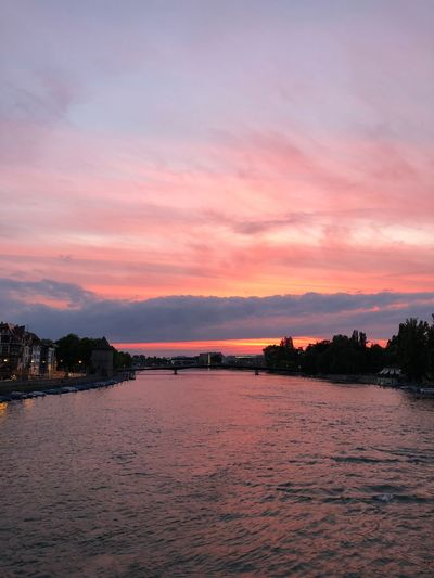 Pink sun Sky Sunset Cloud - Sky Water Beauty In Nature Scenics - Nature Tranquility Dusk Sea No People Nature Orange Color Romantic Sky Waterfront