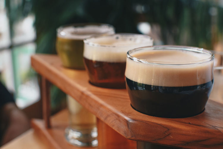 Sampling a Flight of beer Bar Beer Beer - Alcohol Close-up Coffee - Drink Day Drink Drinking Glass Flight Of Beer Focus On Foreground Food And Drink Food And Drink Freshness Froth Frothy Drink Indoors  No People Refreshment Sampling Some Beer Table Wood - Material