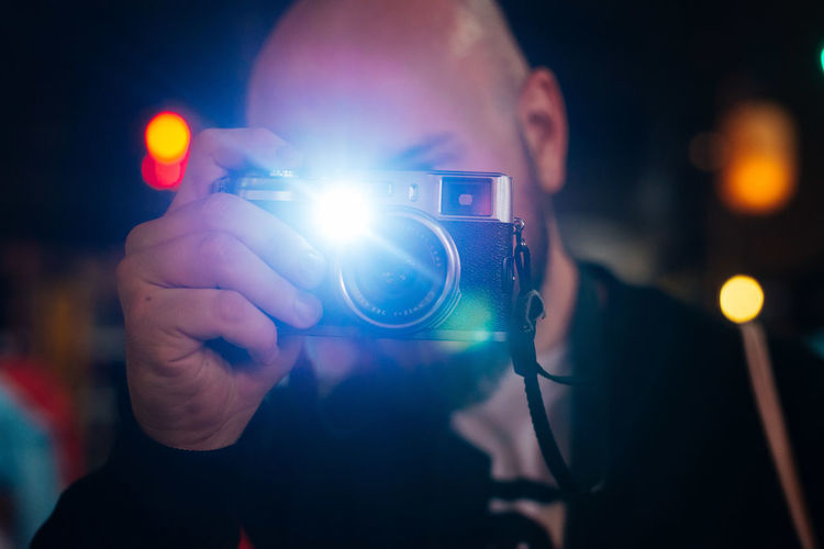 Flash! Adult Camera - Photographic Equipment Camera Flash Close-up Holding Human Body Part Human Hand Illuminated Indoors  Night One Man Only One Person Only Men Paparazzi Photographer People Photographer Photographing Photography Themes Real People SLR Camera Technology