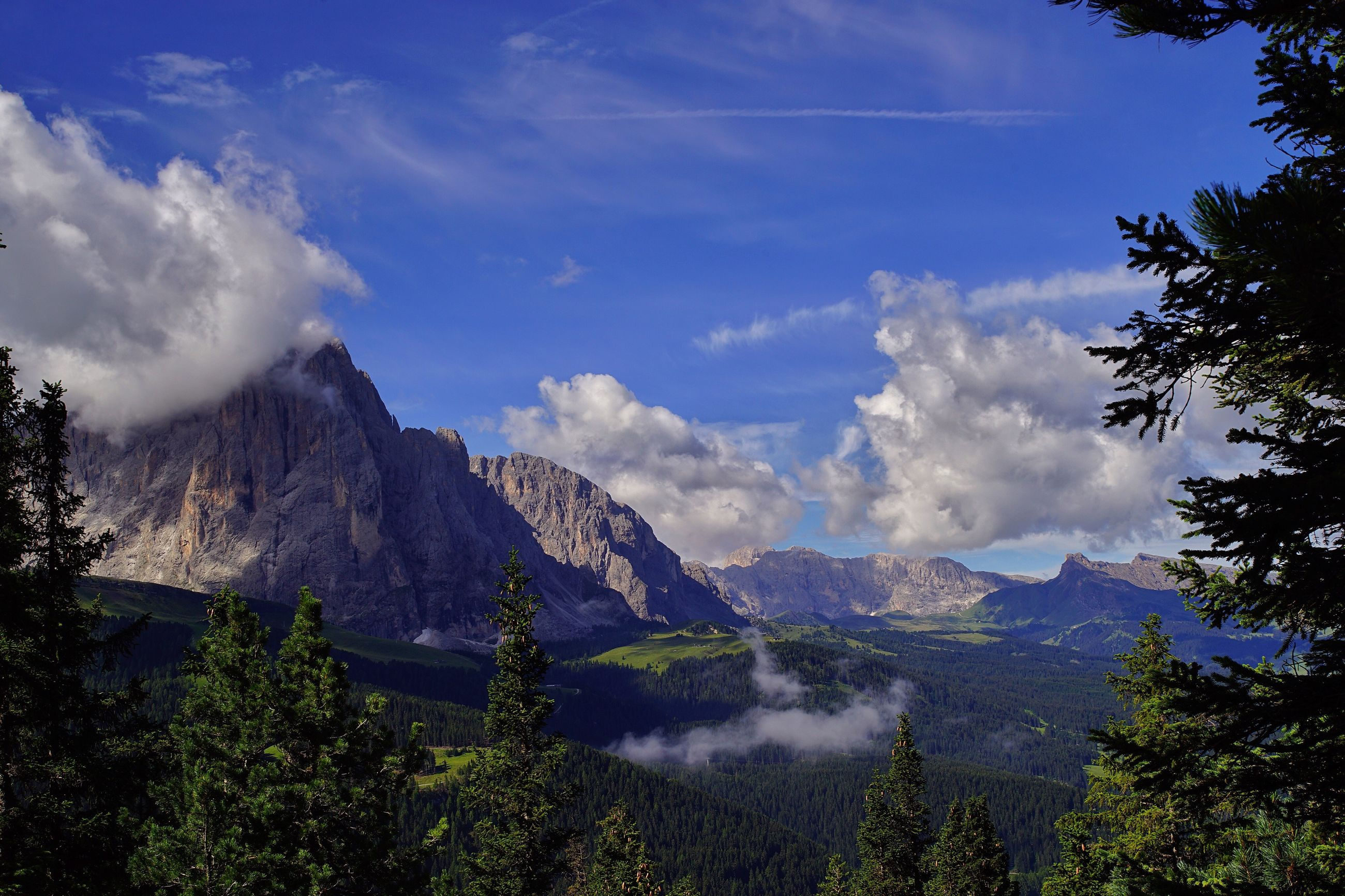 mountain, sky, nature, no people, landscape, beauty in nature, scenery, range, blue sky, tree, outdoors, day