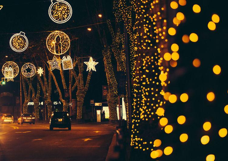 Illuminated christmas lights hanging at night