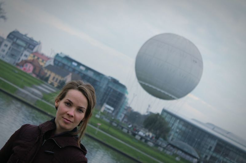 Portrait Of Young Woman Hot Air Balloon In City