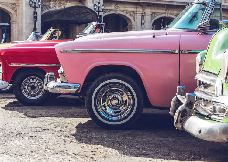 Vintage cars on road in city