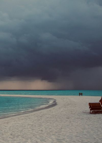 Stormy Cloud At Paradise Beach Sea Land Water Beach Sky Cloud - Sky Sand Scenics - Nature Horizon Nature Horizon Over Water Travel Destinations Overcast Outdoors Tranquil Scene Beauty In Nature Trip Vacations Stormy Weather Sunbed Paradise Indian Ocean Relaxing Sandbar