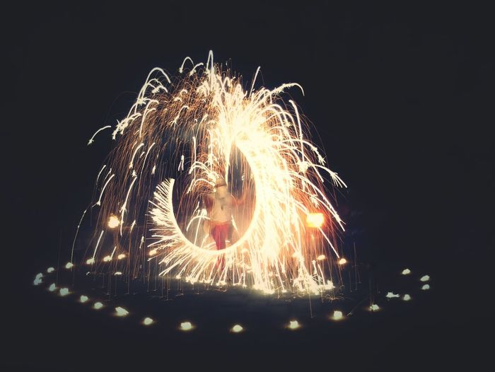 Close-up of illuminated fireworks against sky at night
