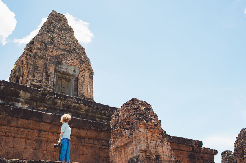 Siem Reap Cambodia Angkor Curly Hair Girl Architecture Built Structure Sky History The Past Travel Destinations One Person Nature Building Exterior Travel Tourism Lifestyles Ancient Day Low Angle View Building Old Ruin Leisure Activity Religion Real People Archaeology Ancient Civilization Ruined