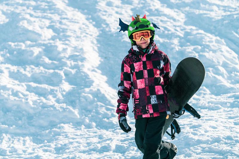 Portrait of boy with snowboard