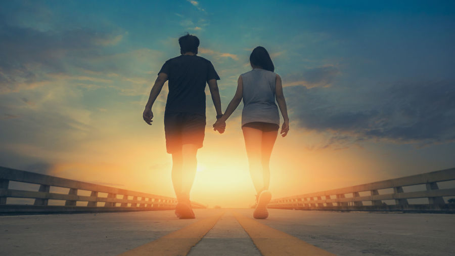Couples runners are walking hand in hand to get to their destination. It is the happiness of the family. Family Vacation Happy Hands Adult Together Island Casual Cheerful Shadow Lifestyles Remote Ari Exotic Affection Relaxation Romantic Destination Lovers Lifestyle Romance Stroll Honeymoon Vacations Journey Leisure Relationship Joy Happiness Aim Friendship Love Peak Success Adventure Enjoying Endurance