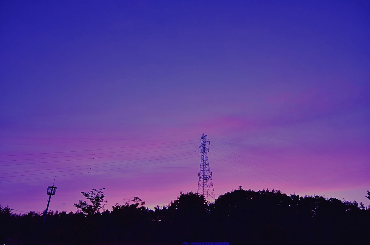 Low Angle View Of Electric Tower Against Purple Sky At Twilight