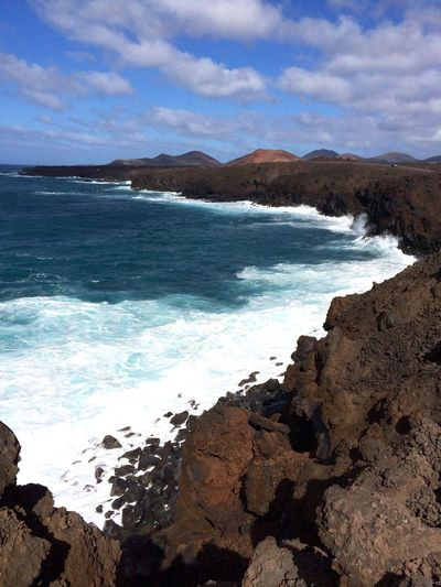 Sea Beauty In Nature Nature Sky Scenics Cloud - Sky Rock - Object Water Mountain Tranquility Tranquil Scene No People Day Beach Outdoors Horizon Over Water Wave Vulcanic Landscape Vulcanic Beach Lanzarote Island SPAIN Mare Tenger