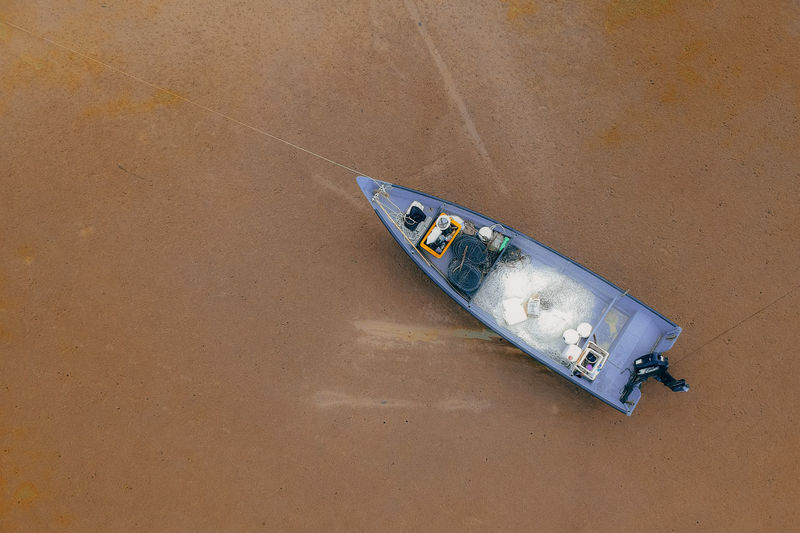 Nautical Vessel Transportation High Angle View No People Mode Of Transportation Day Land Nature Water Single Object Beach Outdoors Moored Abandoned Metal Sand Paper Old Wood - Material Wheel