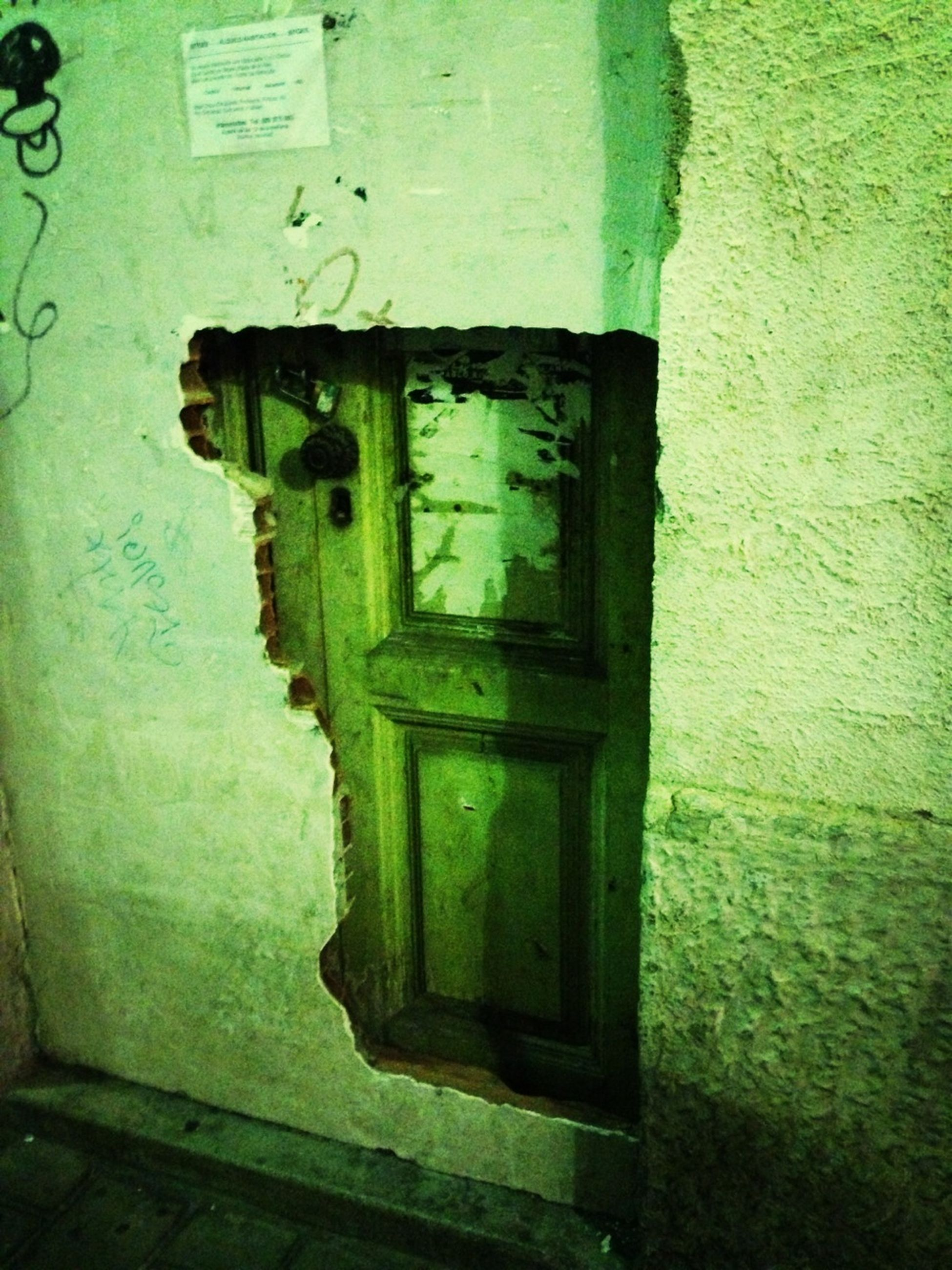 door, wall - building feature, built structure, architecture, green color, closed, old, close-up, building exterior, wall, protection, safety, security, no people, day, outdoors, number, metal, old-fashioned, entrance