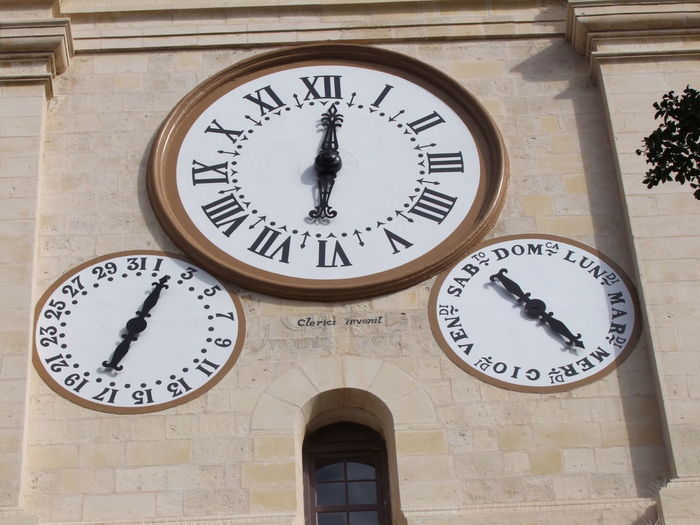 Close up of Time, Day & Date Dials on the Bell Tower, St John's Cathedral (constructed 1573 - 1577), Misrah Ir-Assediu L-Kbir, Valletta, Malta Valletta Malta Clock Time No People Number Instrument Of Time Minute Hand Clock Face Accuracy Day Circle Date Communication Low Angle View Wall Clock Sunlight Dials Clock Dial Date Dial Day Dial Cathedral Church Bell Tower Clock Tower