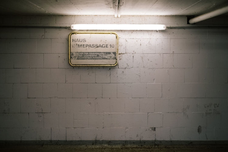 Hannover Linden Wall - Building Feature Communication Architecture Indoors  Text No People Sign Western Script Wall Illuminated Built Structure Information Electricity  Information Sign Lighting Equipment Bathroom Fluorescent Light Script Abandoned Ceiling