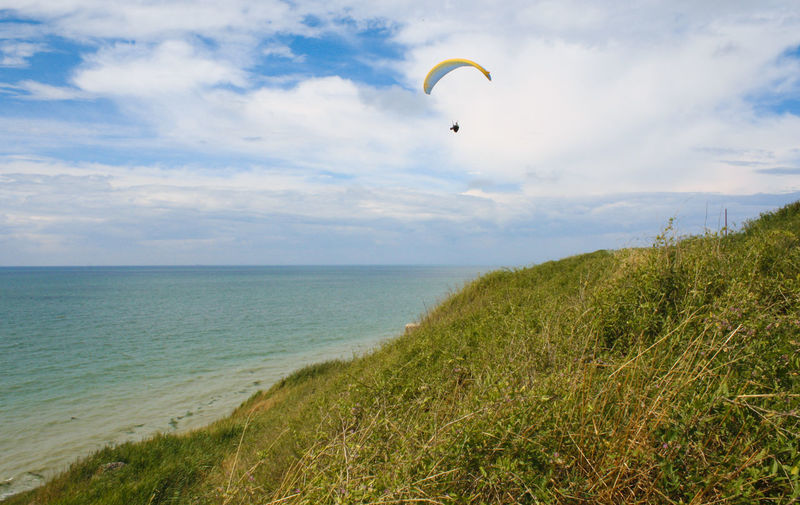 Adventure Beach Beauty In Nature Extreme Sports Grass Horizon Horizon Over Water Land Paragliding Sea Sport