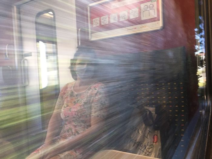Blurred motion of person seen through glass window