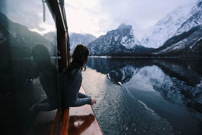 Girl on boat on the Königssee in Bayern, Germany with mountain backdrop Alps Bayern Bayern Germany Beauty In Nature Boat EyeEmNewHere Germany Girl Königssee Lake Leisure Activity Lifestyles Mountain Mountain Range Nature One Person Outdoors People Real People Reflection Scenics Tranquil Scene Tranquility Water Woman