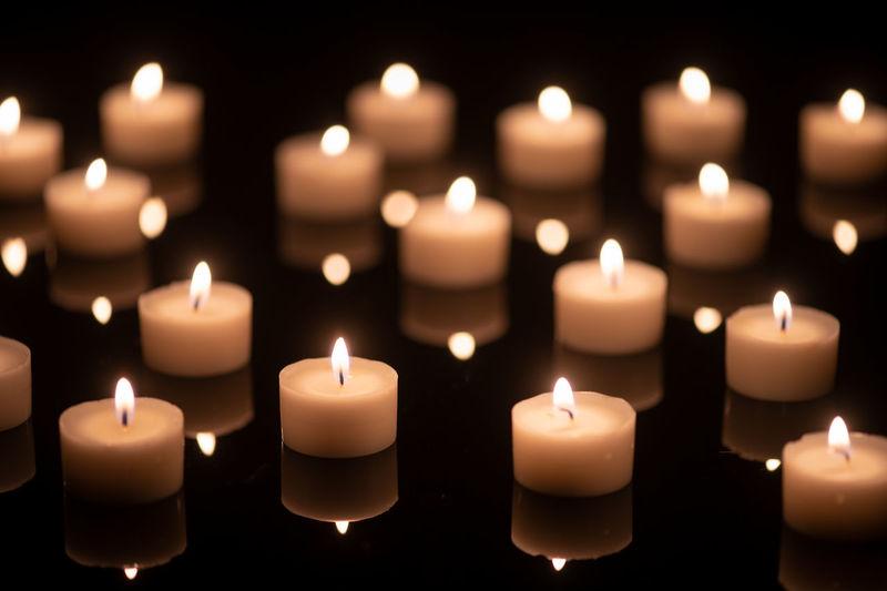 Close-up of illuminated candles burning