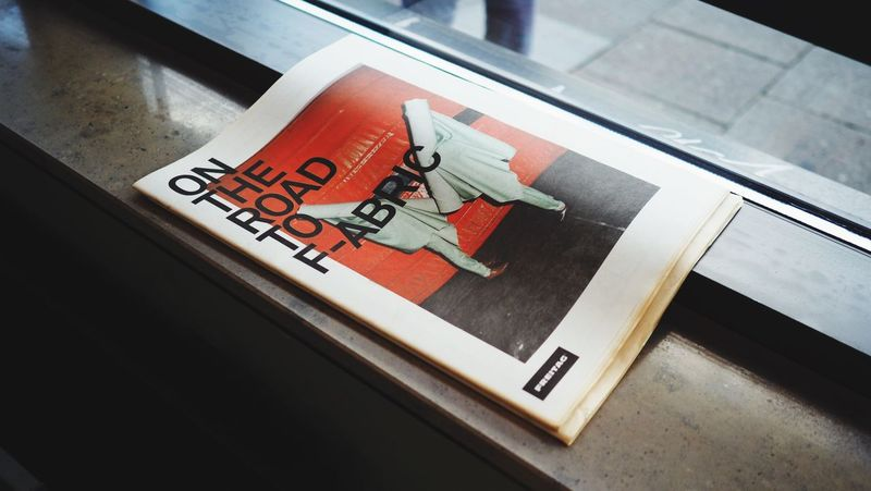 Text High Angle View Communication Indoors  No People Day Close-up Newspaper Freitag Hamburg Germany Display