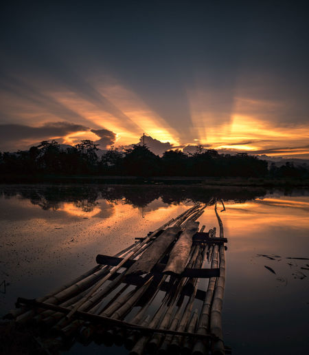 morning view from pangkep, sulwesi selatan indonesia Reflection Lake Sunset No People Cloud - Sky Tranquility Scenics Sky Landscape Water Outdoors Nature Tree See The Light EyeEmNewHere Sunrise N Sunsets Worldwide  Sunlight Lost In The Landscape Backgrounds Capture The Moment Skyscraper Couldandsky Rays Of Sunshine Tranquility Perspectives On Nature Be. Ready.