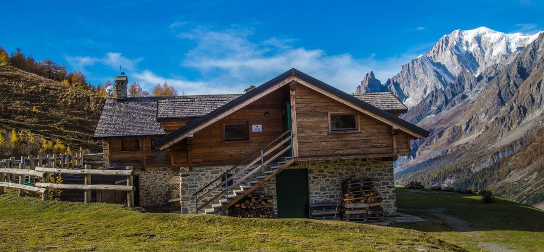 refuge bonatti,courmayeur,italy Built Structure Architecture Building Exterior Sky Cloud - Sky Building Mountain Nature Day House No People Grass Plant Wood - Material Beauty In Nature Landscape Scenics - Nature Land Old Outdoors Cottage