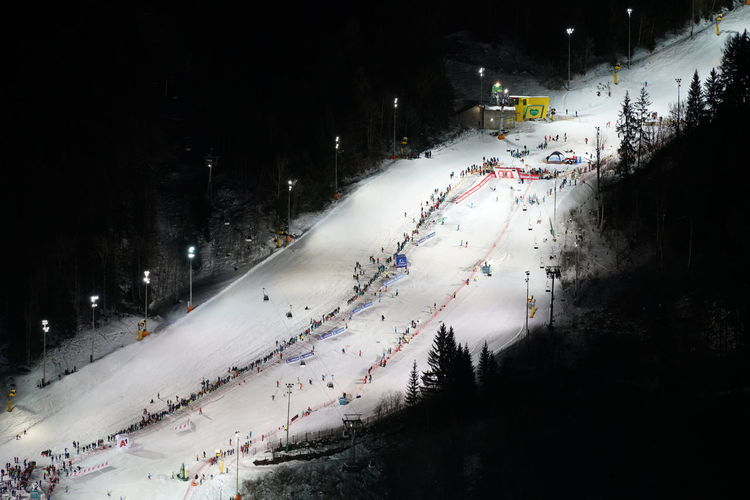 Skirace The Nightrace Architecture Beauty In Nature Building Exterior Built Structure City Cold Temperature Extreme Sports High Angle View Illuminated Motion Mountain Nature Night No People Outdoors Road Schladming Ski Lift Sky Snow Sport Tree Weather Winter Worldcup