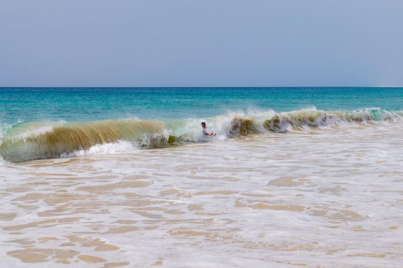 Body surfing at santa monica beach, boa vista, cape verde