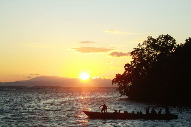sunset activity Indonesia_photography Visit Indonesia Halmahera Selatan Long Boat Traditional Transportation Daily Life Halmahera Pesona Indonesia Cultural Water Sunset Sea Silhouette Togetherness The Great Outdoors - 2018 EyeEm Awards