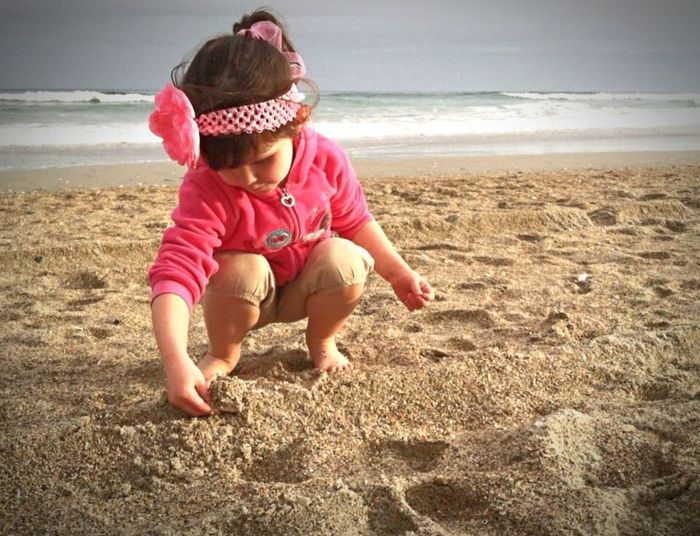 Discover The World Beach Childhood Sand Full Length Sea Playing One Person Day Outdoors Sandy Beach Sandy Sand & Sea Children Photography Child Child At Play Child At The Beach Child Playing Child At Sea Digging