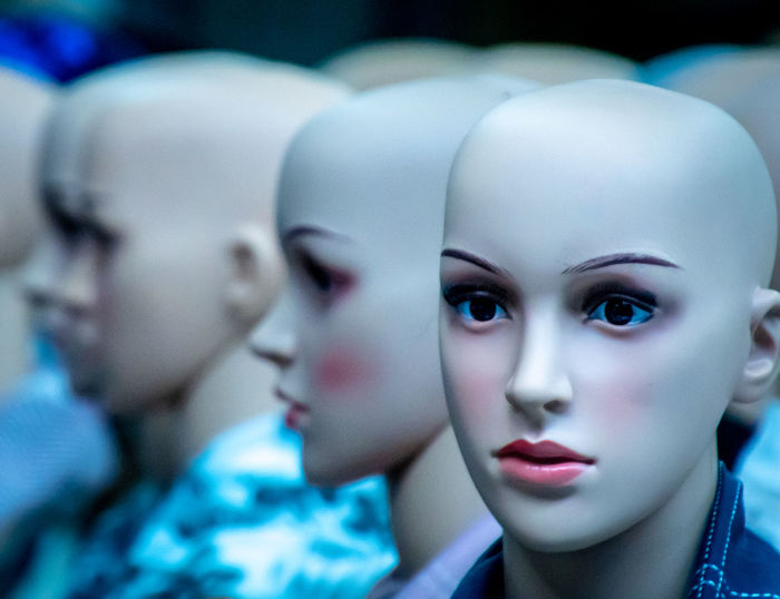 Close-up of mannequins in clothing store