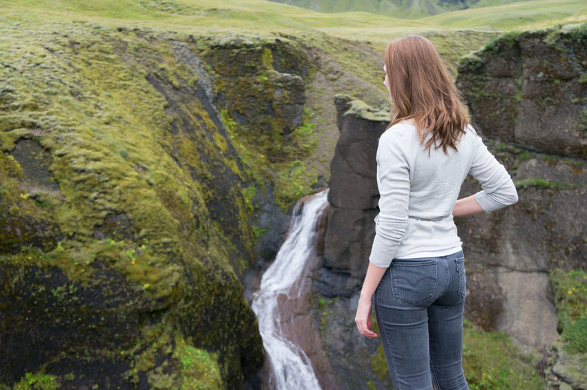 Fjaðrárgljúfur Canyon Adventure Fjaðrárgljúfur Green Iceland Adventure Beauty Canyon Casual Clothing Day Landscape Long Hair Nature One Person One Woman Only Outdoors Rear View Waterfall Women Young Women