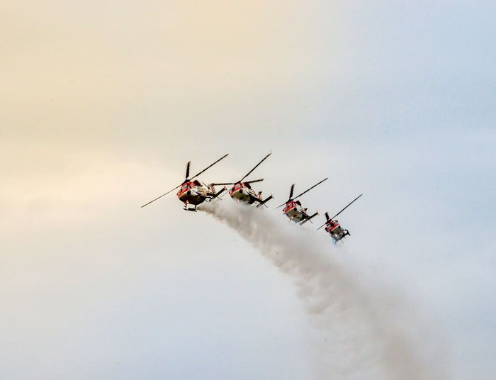 Low Angle View Of Helicopters In Sky During Air Show
