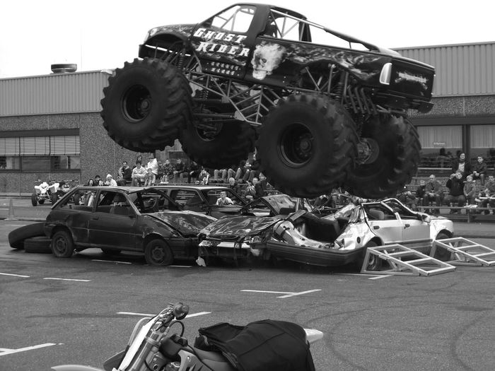 It was one hell of a ride. The Drive Car Outdoors People Monster Trucks Trucks Adventure Crash Excitement Public Adrenalin Black And White Germany Entertainment Car Show Show