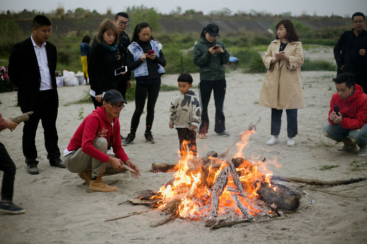 Bonfire Burning Campfire Child Childhood Day Fire Fire - Natural Phenomenon Flame Full Length Girls Group Of People Heat - Temperature Land Males  Men Nature Offspring Outdoors Standing Women