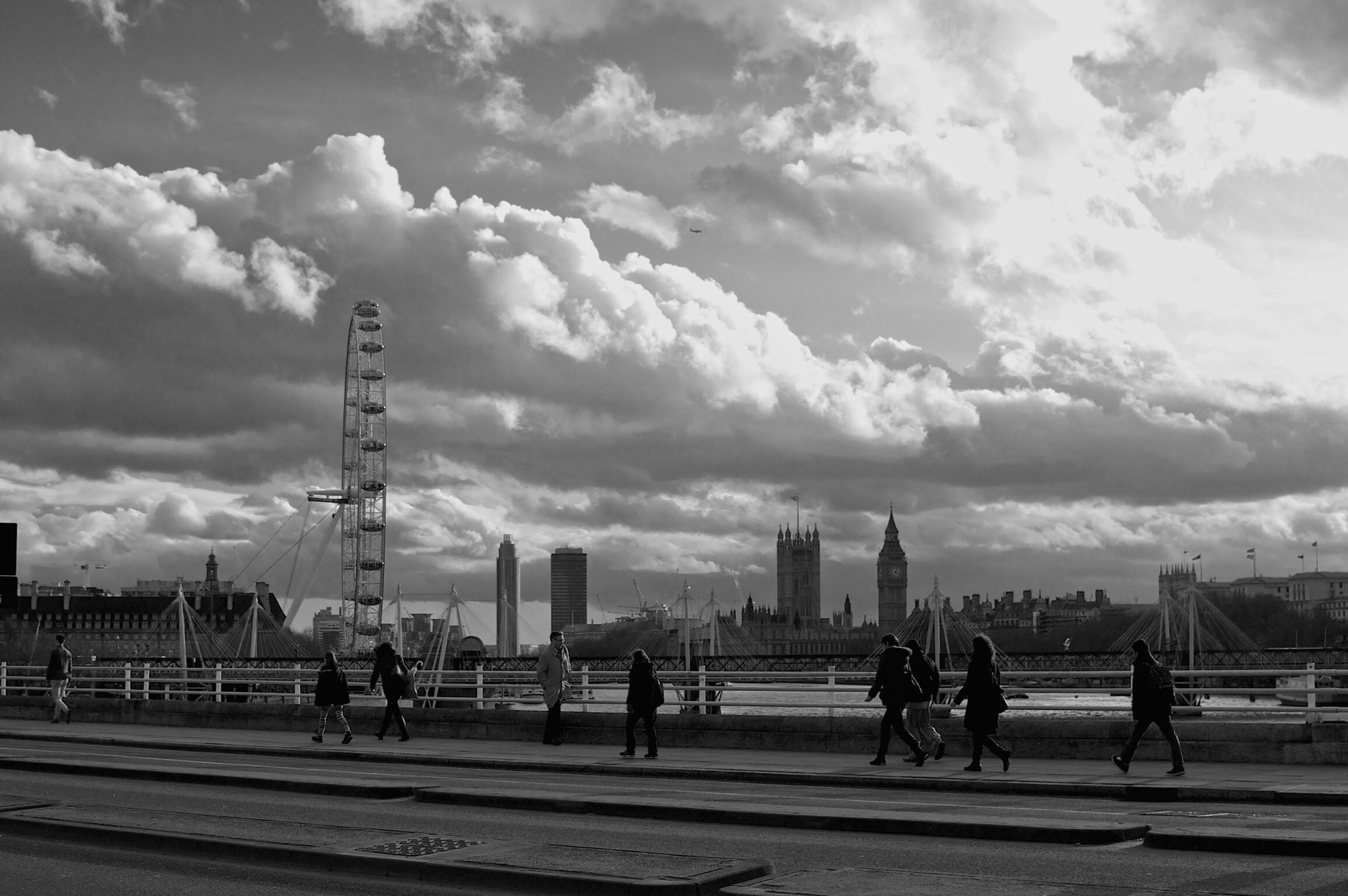 sky, cloud - sky, built structure, architecture, cloudy, men, building exterior, city, person, large group of people, lifestyles, cloud, leisure activity, road, city life, street, walking, street light, transportation