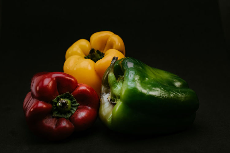 Close-up of bell peppers against black background