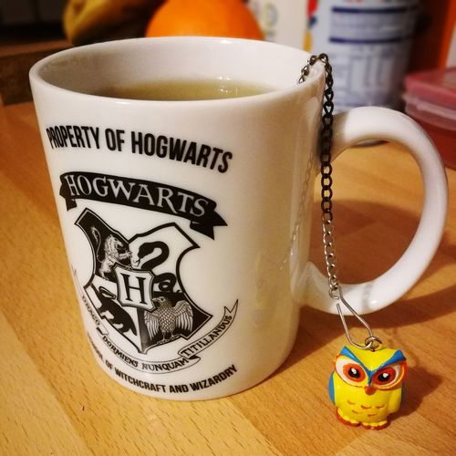 Harry Potter tea. Owl Harry Potter Harry Potter Mug Tea Food Food And Drink Drinks Tea Wooden Table White Yellow House Home Arts Culture And Entertainment Food Stories Text Drink Food And Drink Indoors  Table No People Day Close-up Freshness