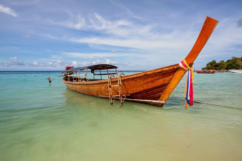 Holiday in Thailand - Beautiful island of Koh Lipe with sandy beaches Adaman Sea Andaman Beach Blue Boat Clear Day Flora Golden Holiday Koh Koh Lipe Lipe Nature No People Outdoors Relax Sand Sea Thailand Vacation Vacation Destination Water Wave