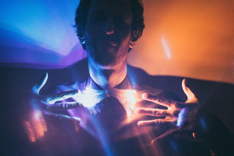 Close-Up Of Man In Illuminated Room