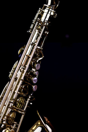 Music Instrument Alto Saxophone, Saxophone Isolated on black Studio Shot Black Background Indoors  Musical Instrument Arts Culture And Entertainment Music Wind Instrument Saxophone Close-up No People Copy Space Metal Gold Colored Shiny Brass Instrument  Single Object Musical Equipment Night Jazz Music In A Row
