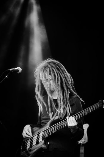 Performance of a bass player in black and white