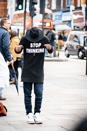 Rear view of two people walking on street