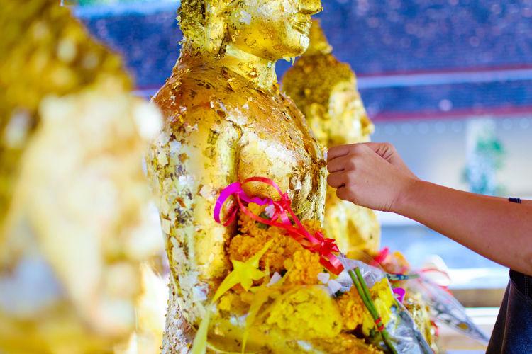 Gilding. Gilding Buddha Buddhism Buddhist Temple Human Hand Multi Colored Women Holding Close-up