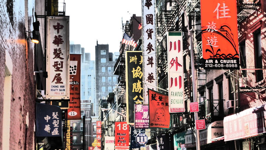 Chinatown NYC Street Purplesnail Signs Architecture Building Exterior Built Structure City Communication Day Hanging No People Outdoors Text Travel Destinations