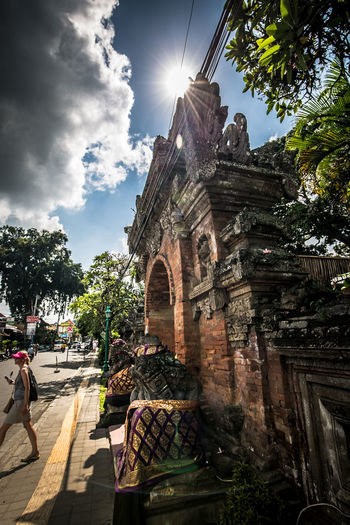 Ubud: Palace Front Gate Ancient Architecture Built Structure Cloud Cloud - Sky Day History Low Angle View No People Old Outdoors Sky Spirituality Sun Sunbeam Sunlight Sunny Temple - Building The Past Tourism Travel Destinations Tree Finding New Frontiers The Traveler - 2018 EyeEm Awards