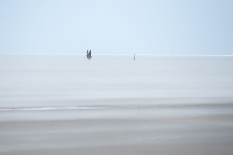 Beauty In Nature Clear Sky Day Horizon Over Water Nature Outdoors People Real People Sandstorm Scenics Sea Sky Storm The North Sea Tranquility Two People Two People Alone In Nature Water Watt Wattenmeer Weltnaturerbe Wattenmeer World Heritage Site By UNESCO Wadden Sea Breathing Space