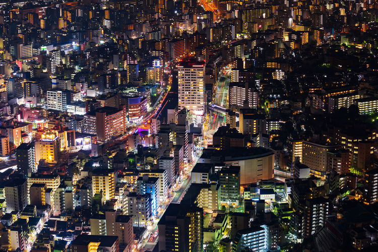 High angle view of illuminated modern buildings at night