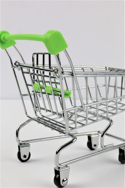An concept Image of a isolated Shopping cart Business Isolated Office Service Shopping Business Finance And Industry Cart Close-up Consumerism Costumer Costumers Day Money Retail  Shopping Cart Supermarket Trolley